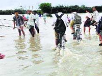 Flood scene grim; CM rues lack of Central aid
